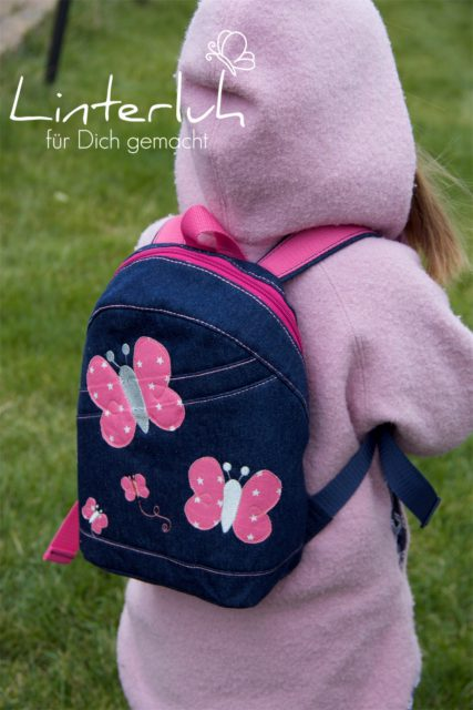 ROANI Hansedelli Kinderrucksack nähen für Kinder Schnittmuster Rucksack jeans pink Schmetterlinge
